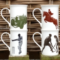 Front aspect of a unique set of four British made Georgie Parker bone china mugs.